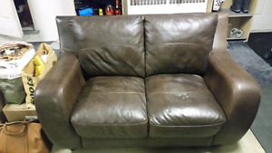 Leather and vynyl love seat