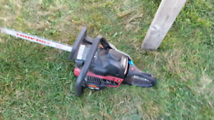 Troy Bilt chainsaw w/case. $50.00