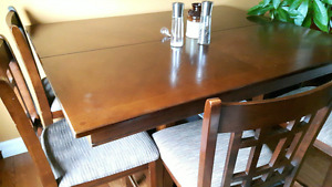 Pub style table and 8 chairs for sale