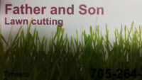 Father and Son Lawn Cutting