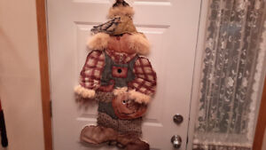 Handmade and quilted scarecrow door hanging