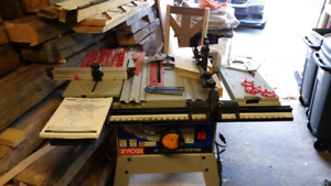 Ryobi BT3100 table saw with accessories and mobile base