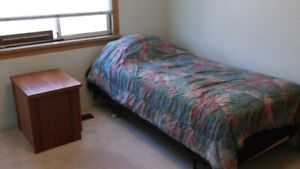 Quiet bedroom and shared main floor, 41st Ave. and Fraser St.