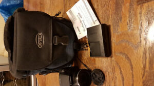 Canon Powershot camera.  Used twice. Comes with charger and bag.