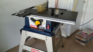 Ryobi Table saw with heavy metal stand.