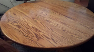 Round Pine Dining Table with leaf and four matching chairs