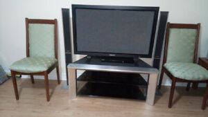 """7 Chairs + Samsung 46 """"+ TV Stand + 2 Panasonic Speakers & DVD"""