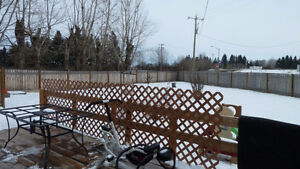 1/3 ACRE FULLY FENCED 2 BEDROOM mins to Fort Sask.