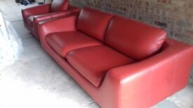 Large red retro style leather sofa and chair