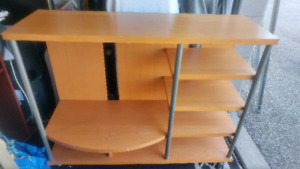 Tv stand unit with shelf on casters