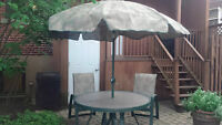 Outdoor table,  4 stackable chairs and matching umbrella