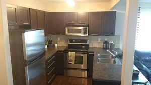 Safe, Beautiful 2 bedroom + basement townhome Move - in NOW