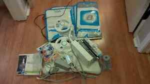 Nintendo Wii w/ balance board, DDR mat, controllers and games
