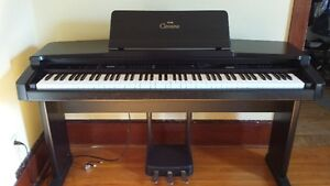 Yamaha Clavinova Electric Piano plus bench and quilted cover