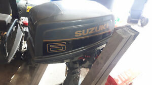 6hp suzuki shortshaft like new only 20hrs on motor.$900 firm