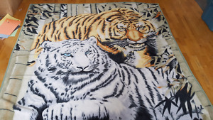 Tiger comforters and two throw blankets