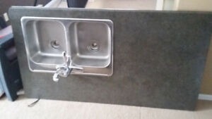 65 and half inches long counter top and stainless double sink