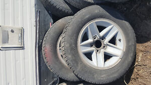 4 GM chevy iroc rims and tires.