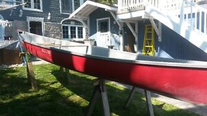 15 foot Headwaters canoe and paddles