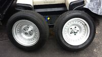 215 60r 15 with American racing outlaw wheels perfect condition