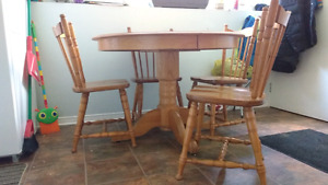 Solid wood table and 4 chairs very sturdy set