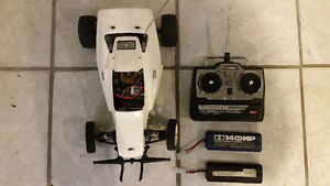 ACOMS racing car works good comes with remote and two batteries West Island Greater Montréal image 1