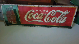 Coca Cola bottle sign