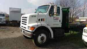 97 S/A 20' Ford flatbed. 188847 km. 6900 obo