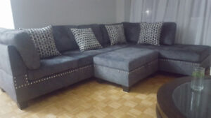 $950 brandnew 1wk old gre fabric sectional with storage ottoman