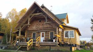Stunning log house on 9 plus acres.Overlooking Lake Dore.