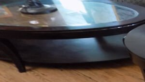 Oval glass inlaid coffee table and matching round end table