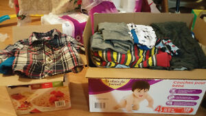Two boxs of baby boy clothes