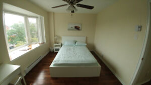 Bright Upper level Front View Room for Rent in a Condo