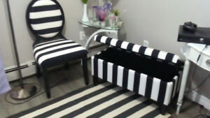 Black and white Ottoman, chair ,lamp, rug