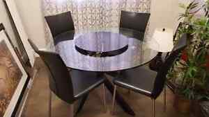 Glass dinning table with lazy sussane for quick sale 700 only...