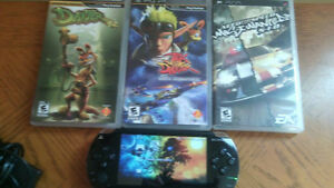 selling sony playstation portable. 1001 four games/wcharger