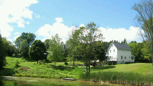 Maintained home on 17 acres with a private flowing pond!
