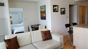 Oct 29: Furnished 1 Bedroom + Den downtown @ Maple leaf sq