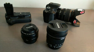 Canon T3i with 50mm + 10-18mm + 28-135mm + battery grip & more