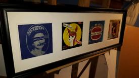 Original framed, Sex Pistols singles.