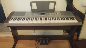 Portable Grand piano barely used in mint condition