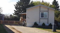 Lovely Mobile home in top westend community...large yard!