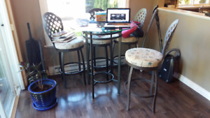 Round glass top table with 4 bar stool chairs