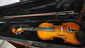 Violin , with bow and case.