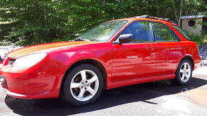 2006 Subaru Impreza Hatchback with roof rack and towing hitch