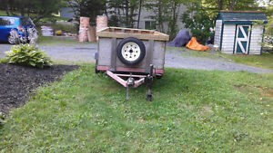 4' x 8' Utility Trailer with treatd plywood sides.