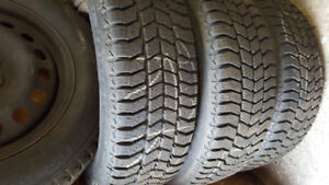 4 like new winter tires/ P-225/60 R -17 rims .