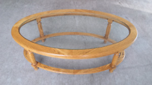 Oval glasstop wood coffee table