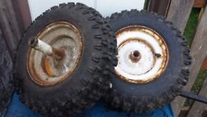 Snowblower tires on rims.
