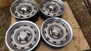 4 dodge ram 16x7 steel wheels with rings and centers